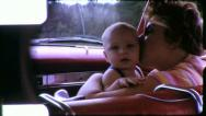 Stock Video Footage of Loving MOTHER And Baby Car Riding Infant 1960 Vintage 8mm Film Home Movie 5580