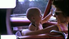 Happy Baby Loving Mother Play in Car Travel 1960s Vintage Film Home Movie 5581 - stock footage