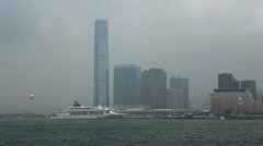 Kowloon Peninsula, ICC, Cruise Ship, Skyscrapers, Hong Kong, Victoria Harbour Stock Footage
