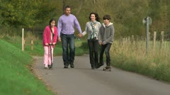 Happy family enjoying a walk outdoors together - stock footage