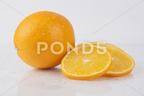 Stock photo of fresh juicy orange on white - fruits series