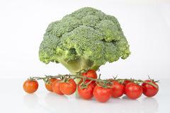 Fresh raw broccoli and cherry tomatoes Stock Photos