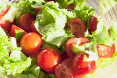 salad with cheery tomatoes and green leaves - stock photo