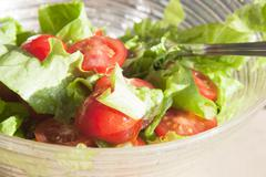 Salad with cheery tomatoes and green leaves Stock Photos