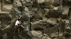 Rock climbing on a ideal vertical wall Stock Footage