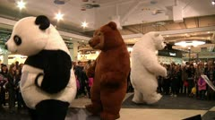 men in suits dancing bears in public 2 - stock footage
