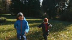 Two little boys playing on the park Stock Footage