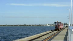 Train travelling down the busselton jetty Stock Footage