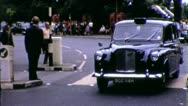 Stock Video Footage of LONDON Taxi Cab Street Scene ENGLAND 1970s (Vintage Film Home Movie) 5598