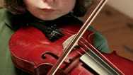 Child learning violin Stock Footage