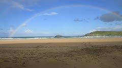 Rainbow at Crantock beach and bay in Cornwall England UK - stock footage