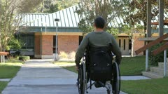 Disabled Man Rolling Away Stock Footage