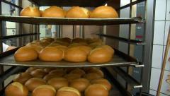 German bakery roll bun out of rotary oven 10768 Stock Footage