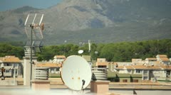 Satellite dish and antenna on roof Stock Footage