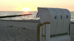 Roofed Wicker Beach Chair at Sunset - Baltic Sea, Northern Germany Stock Footage