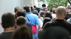 People wait in line Stock Footage