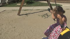 Child Swinging on a Swing Set in a Playground, Little Girl Playing in Park Stock Footage