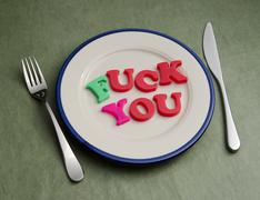fuck you lettering on plate - stock photo