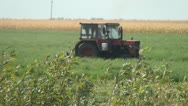 Stock Video Footage of Tractor Cutting the Crop, Haying, Farming, Agriculture