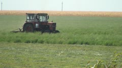 Tractor Cutting the Crop, Haying, Farming, Agriculture Stock Footage