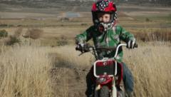 Young boy on dirt bike HD9274 Stock Footage
