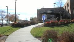Medical worker walking from hospital Stock Footage