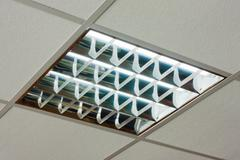 office ceiling with built-in fluorescent shining lamp - stock photo