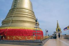 near golden stupa - stock photo