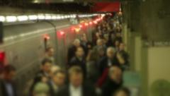 Morning commute anonymous crowd of businessmen and women train Stock Footage