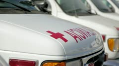 Ambulances in parking lot Stock Footage