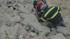 Couple of rescue men searching victims Stock Footage