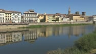 Stock Video Footage of Bridge over river arno.Building is reflected in water.Florence.