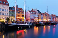 Evening scenery of Nyhavn in Copenhagen, Denmark - stock illustration