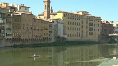 Bridge over river arno.Building is reflected in water.Florence. - stock footage