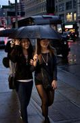 Girls in the Rain in NYC Stock Photos