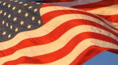 American Flag morning/evening close shot with strong breeze Stock Footage