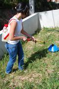 woman fertilizing the soil - stock photo