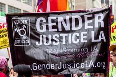 """Gender Justice"" Banner Stock Photos"