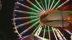 Ferris wheel in amusement park at night Stock Footage