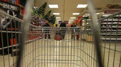 Trolley being pushed around supermarket Stock Footage