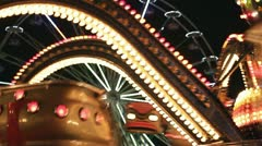 Carousels in amusement park at night Stock Footage