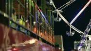 Ferris wheel in amusement park at night Stock Footage