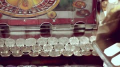 Coins moving inside gambling machine in amusement park Stock Footage