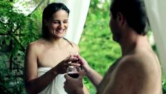 Young couple after shower standing on balcony - stock footage