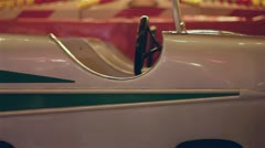 Carousel with cars & motorcycles in amusement park Stock Footage