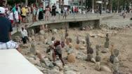 Puerto Vallarta beach boardwalk Malecon man balance rock HD 3735 Stock Footage