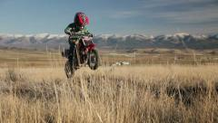 Boy jumping motorcycle slow motion HD9307 Stock Footage