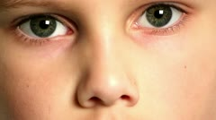 Super close up of cute young boy's face Stock Footage