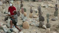 Puerto Vallarta beach boardwalk Malecon men balance rock HD 3736 Stock Footage
