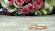 Wedding rings and bouquet Stock Footage